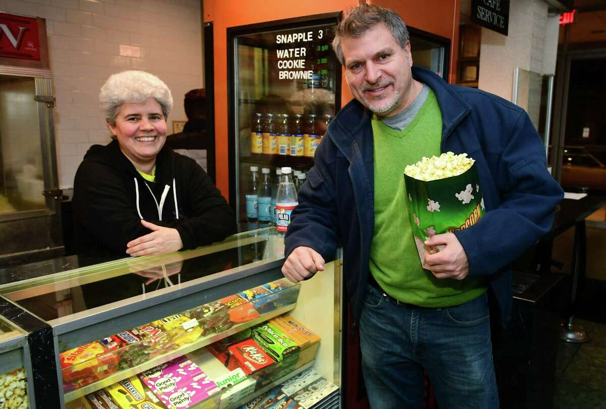 Garden Cinemas employee Diana Yepes sells some snacks to Norwalk resident Matt Zako Thursday, January, 2, 2020, before the theaters final showing at their location in Norwalk, Conn. Garden Cinemas will close after 26 years in operation.