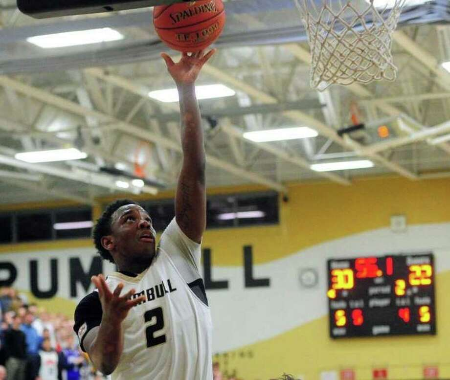 Mileeq Green goes to the basket for Trumbull against Ludlowe. Photo: Christian Abraham / Hearst Connecticut Media / Trumbull Times