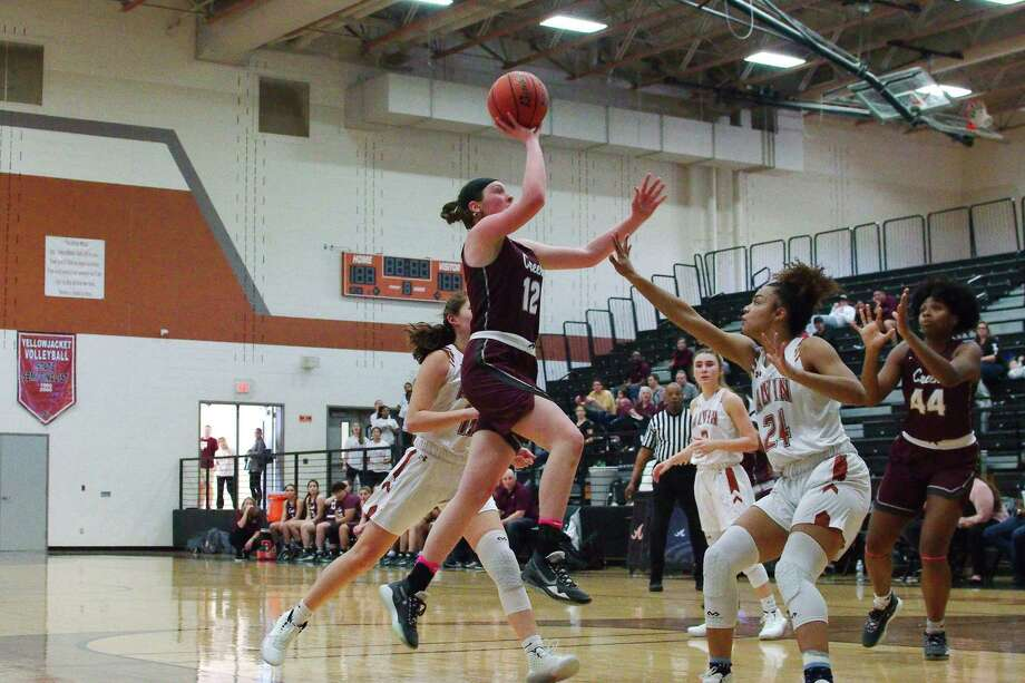 Clear Creek's Olivia Shaw (12) lays up a shot over Alvin's Mariah Byone (24) Friday at Alvin High School in a District 24-6A girls' basketball game. Photo: Kirk Sides / Staff Photographer / © 2019 Kirk Sides / Houston Chronicle