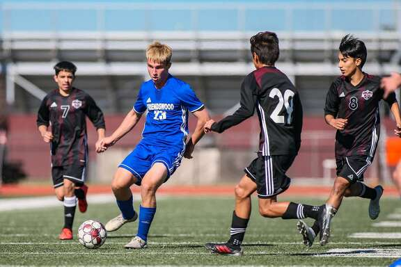 Isaac Logsdon of Friendswood works his way through the Pearland defense in a soccer scrimmage.