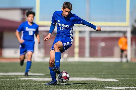 Diego Martinez of Friendswood looks to gain possession in boys' soccer scrimmage against Pearland.