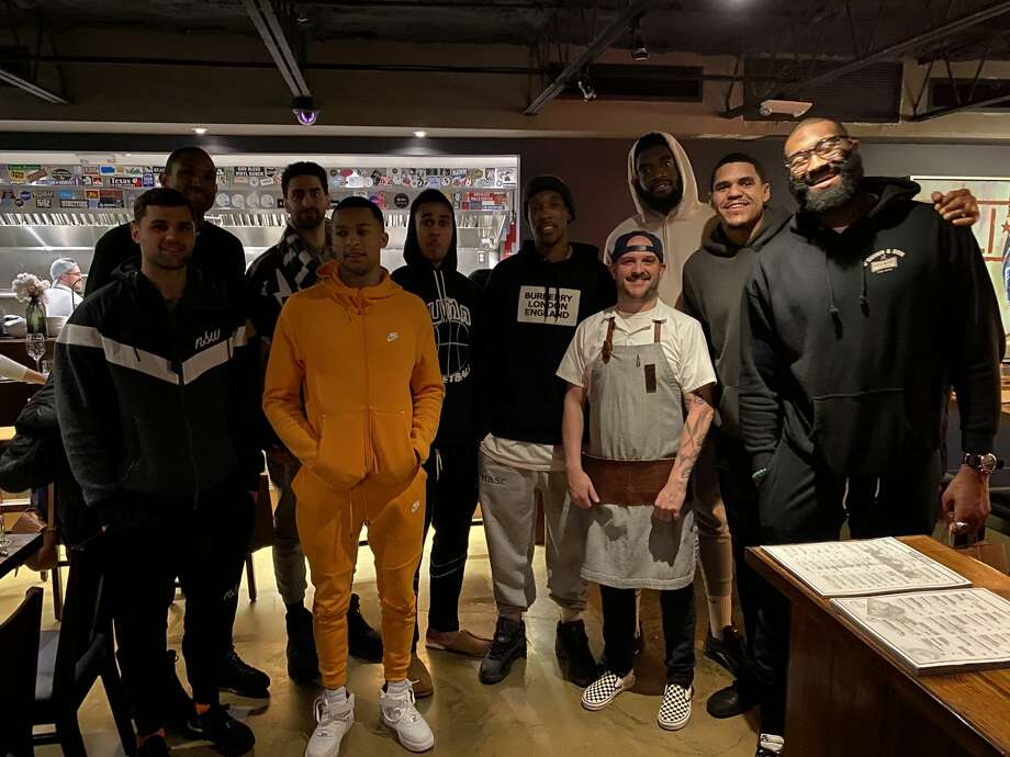 Several Philadelphia 76ers dined at Riel on Jan. 3, 2020. Pictured, from left: Raul Neto, Al Horford, Furkan Korkmaz, Trey Burke, Zhaire Smith, Josh Richardson, executive chef Ryan Lachaine, Norvel Pelle, Tobias Harris and Kyle O'Quinn. Photo: Courtesy