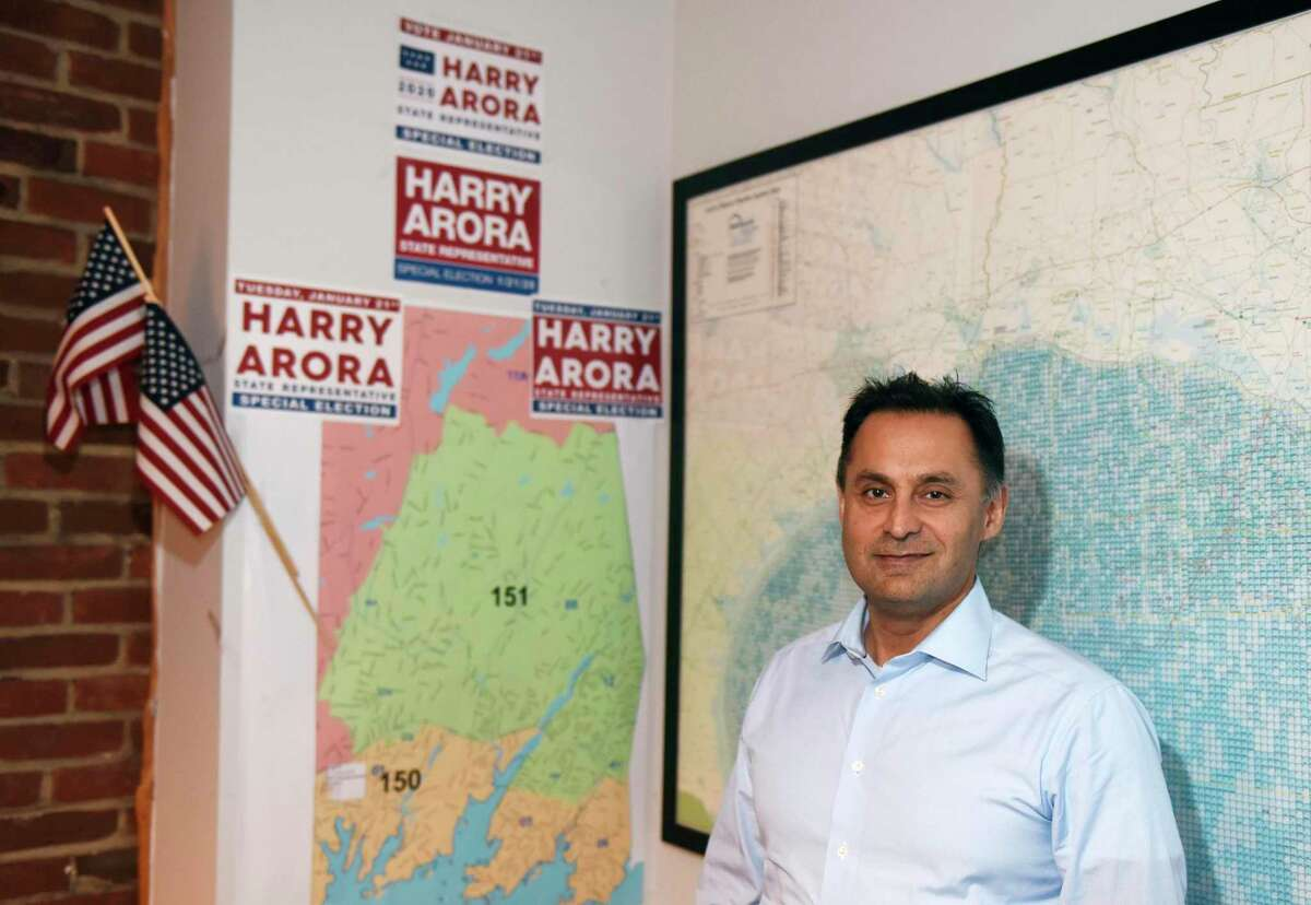 Republican State Representative candidate Harry Arora poses at his office in downtown Greenwich, Conn. Monday, Dec. 30, 2019.