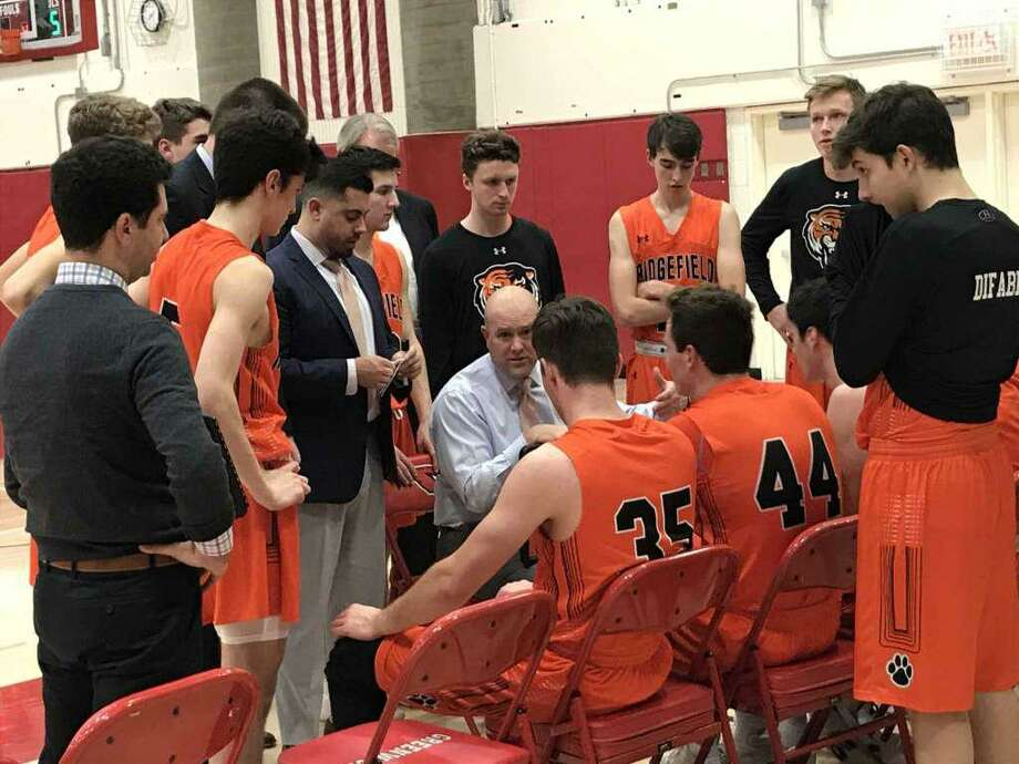Ridgefield boys basketball coach Andrew McClellan addresses his team during the closing minutes of the Tigers game against Greenwich on Friday, January 3, 2020, in Greenwich. Photo: David Fierro / Hearst Connecticut Media