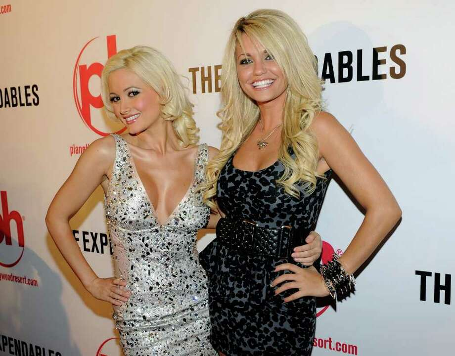 "LAS VEGAS - AUGUST 11:  Model and television personality Holly Madison (L) and television personality Angel Porrino arrive at a screening of Lionsgate Films' ""The Expendables"" at the Planet Hollywood Resort & Casino August 11, 2010 in Las Vegas, Nevada. The film opens nationwide in the United States on August 13, 2010.  (Photo by Ethan Miller/Getty Images) *** Local Caption *** Holly Madison;Angel Porrino Photo: Ethan Miller, Getty Images / 2010 Getty Images"