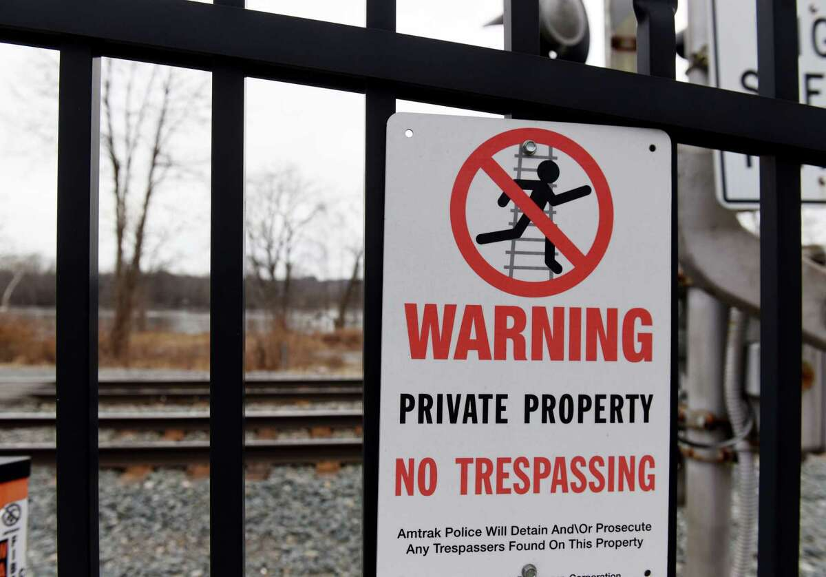 Warning signs prohibit access to an undeveloped village park next to the Hudson River on Friday, Jan. 3, 2020, in Castleton-on-Hudson, N.Y. High speed Amtrak lines run between village streets and the river. (Will Waldron/Times Union)