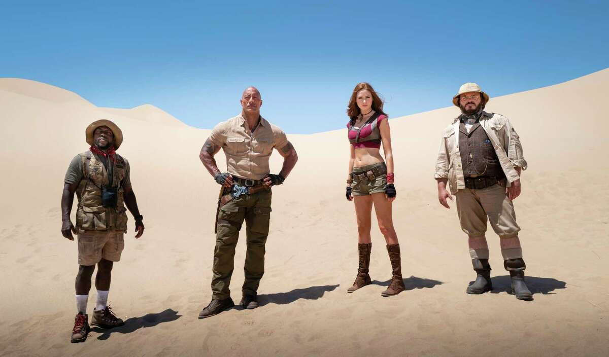 """This image released by Sony shows Kevin Hart, from left, Dwayne Johnson, Karen Gillan and Jack Black in a scene from """"Jumanji: The Next Level."""" (Hiram Garcia/Sony via AP)"""