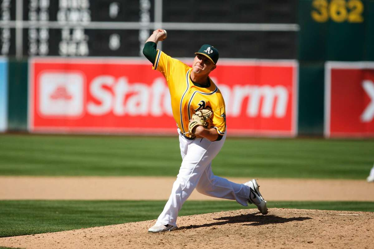 Andrew Bailey of the Oakland A's pitches during the A's versus Twins game. The Oakland Athletics beat the Minnesota Twins 7-3 at the Oakland-Alameda County Coliseum on Sunday, July 31, 2011.