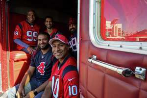 Pavan Pinnamaneni poses for a photograph with his family inside the ambulance he converted into a tailgating vehicle. Photographed before the AFC Wild Card playoff game at NRG Stadium Saturday, Jan. 4, 2020, in Houston.