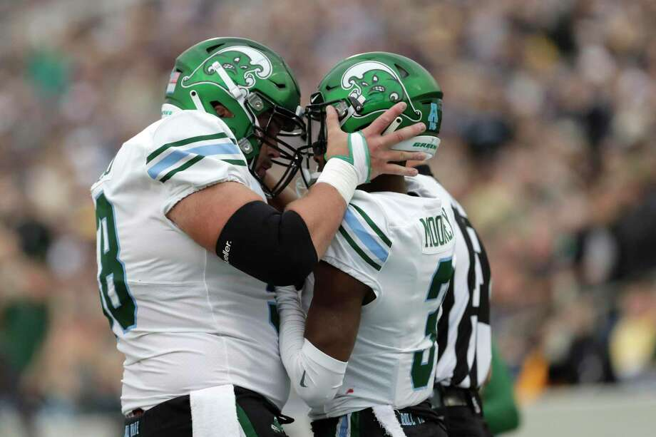 Tulane offensive lineman Christian Montano, left, started every game at center and was named the Walter Camp Foundation's Connecticut Player of the Year Photo: Julio Cortez / Associated Press / Copyright 2019 The Associated Press. All rights reserved