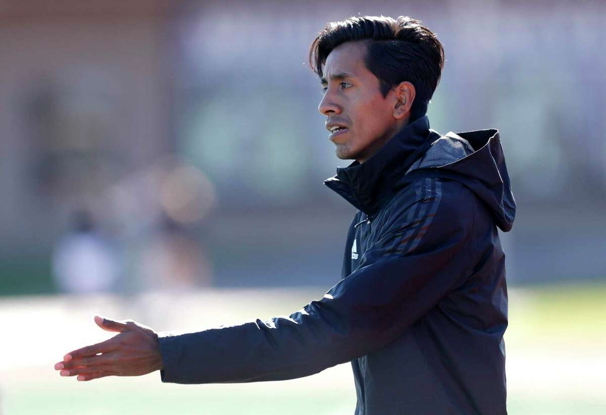 Oak Ridge head coach Victor Olivares instructs players in the first period of a high school soccer match during the Wildkat Showcase, Saturday, Jan. 4, 2020, in Willis.