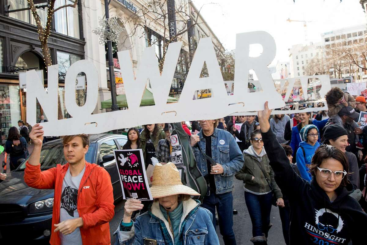 Thousands march down Market Street toward Fourth Street during an anti-war demonstration in S.F.