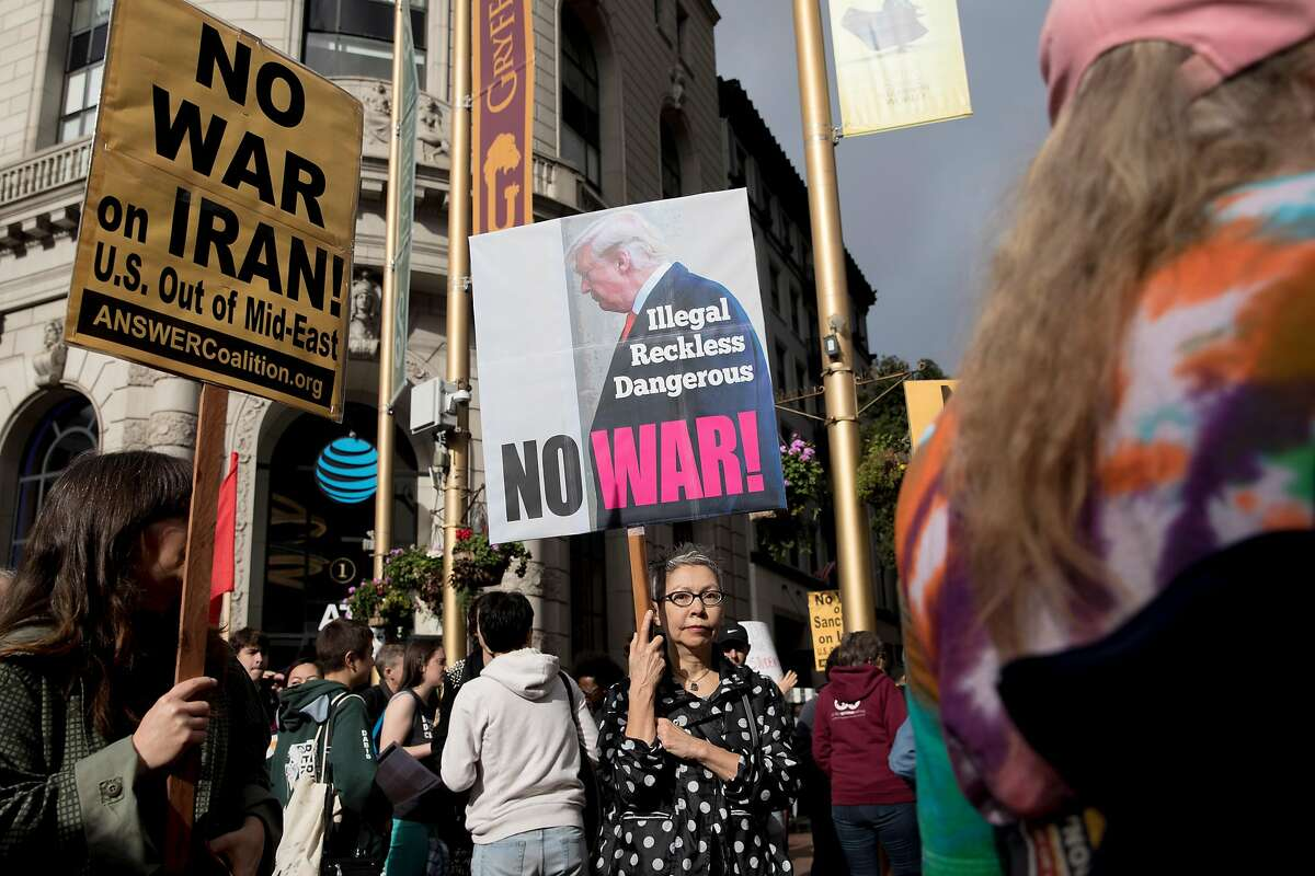 Connie Jeung-Mills of San Francisco carries a protest sign during an anti-war demonstration in San Francisco.