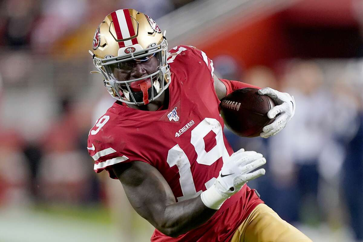 SANTA CLARA, CALIFORNIA - DECEMBER 21: Wide receiver Deebo Samuel #19 of the San Francisco 49ers carries the ball against the defense of the Los Angeles Rams during the game at Levi's Stadium on December 21, 2019 in Santa Clara, California. (Photo by Thearon W. Henderson/Getty Images)