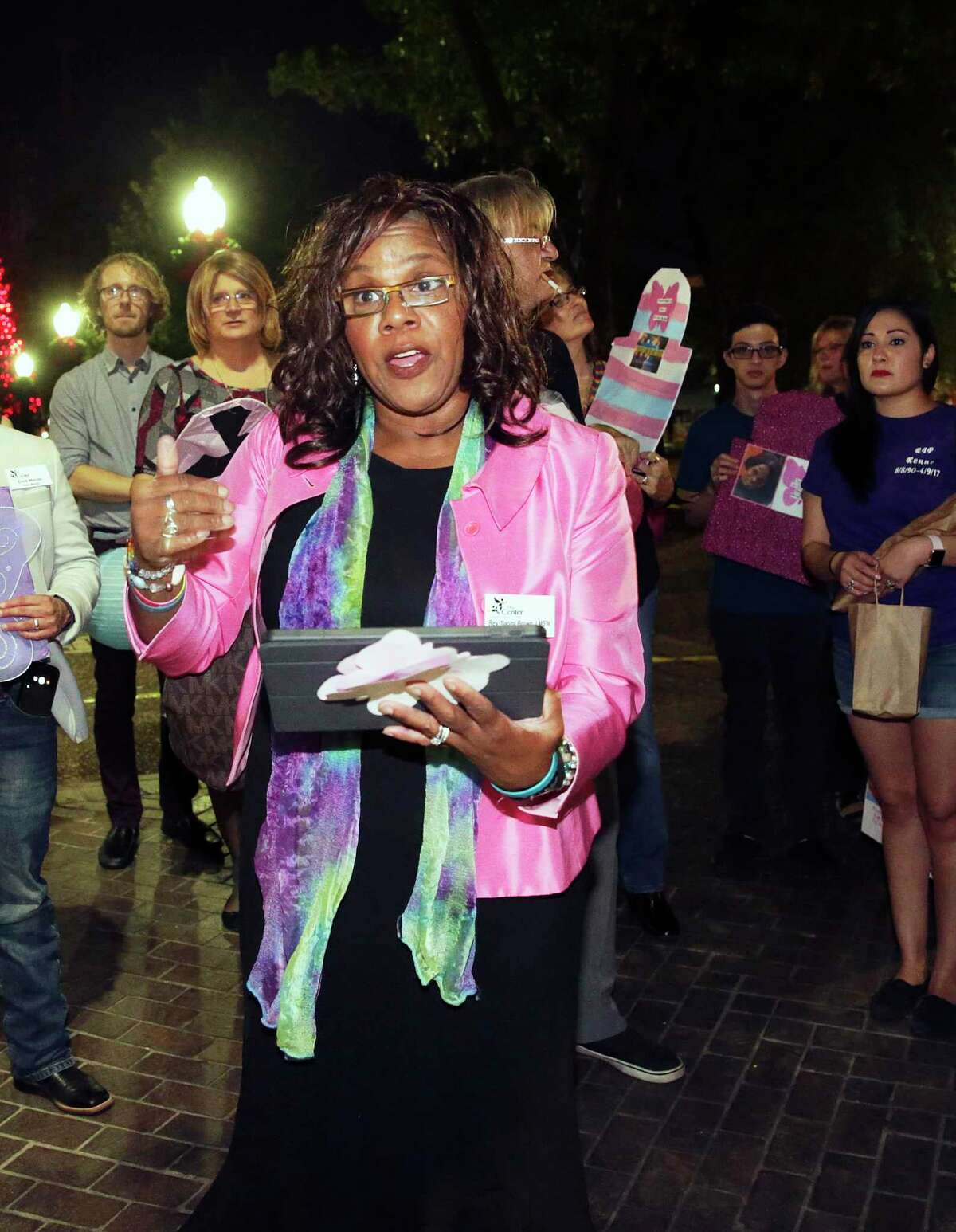 Rev. Naomi Brown of the Metropolitan Community Church reads the list of the deceased as the Transgender Day of Remembrance is observed in Travis Park and Travis Park Church on November 16, 2017.