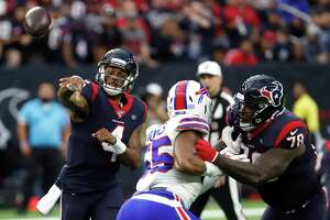 Houston Texans quarterback Deshaun Watson (4) throws a pass against the Buffalo Bills during an AFC wild card playoff game at NRG Stadium on Saturday, Jan. 4, 2020, in Houston.