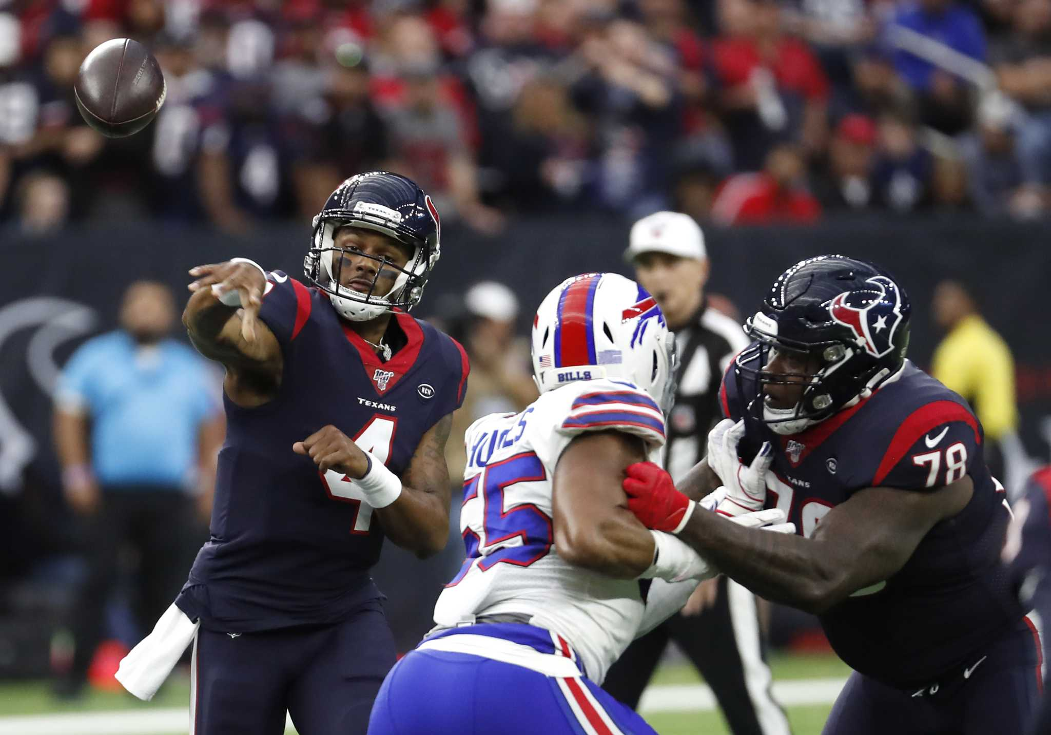 Texans rally past Bills to take playoff