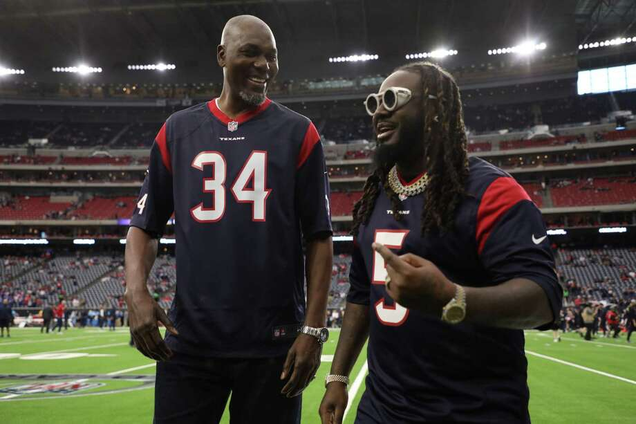 PHOTOS: Hakeem Olajuwon and T-Pain at the Texans-Bills playoff game HOUSTON, TEXAS - JANUARY 04: Former NBA player Hakeem Olajuwon and Rapper T-Pain are seen prior to the AFC Wild Card Playoff game between the Houston Texans and the Buffalo Bills at NRG Stadium on January 04, 2020 in Houston, Texas. Photo: Christian Petersen, Getty Images / 2020 Getty Images