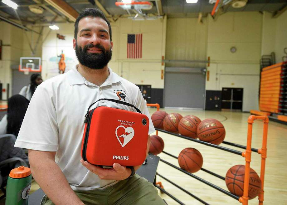 Stamford High School athletic trainer Jordan Napolitano, along with Stamford Athletic Director Chris Passamano were instrumental in resuscitating a referee with an AED (Automated External Defibrillator) after they collapsed during a girls basketball game at the school. Photo: Matthew Brown / Hearst Connecticut Media / Stamford Advocate