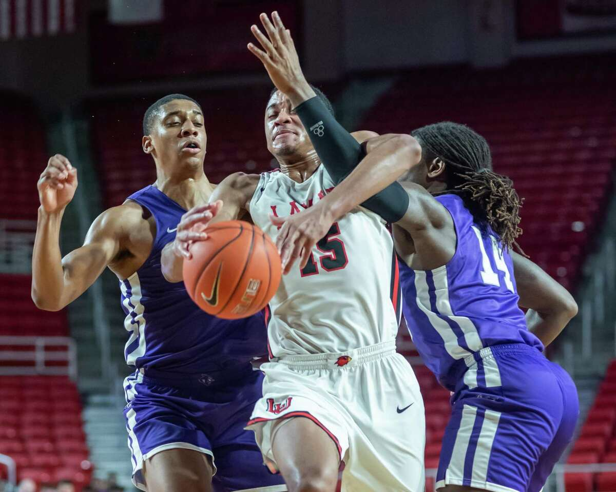 T.J. Atwood (15) gets tangles up with Trey Lenox (14) going up for a shot as the Lamar Cardinals were in a hard-fought battle in their game with the Wildcats of Abilene Christian at the Montagne Center on Saturday, January 4, 2020. Fran Ruchalski/The Enterprise