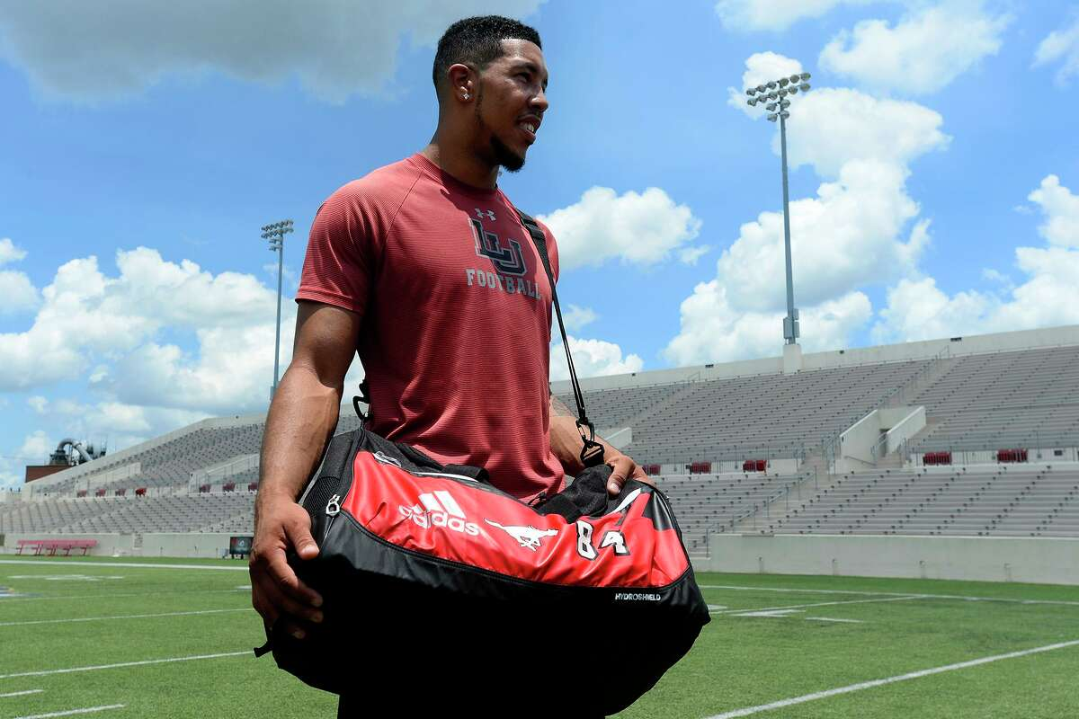 Former Lamar wide receiver Reggie Begelton holds his bag from the Canadian Football League's Calgary Stampeders after working out at Lamar on Thursday afternoon. Photo taken Thursday 7/13/17 Ryan Pelham/The Enterprise