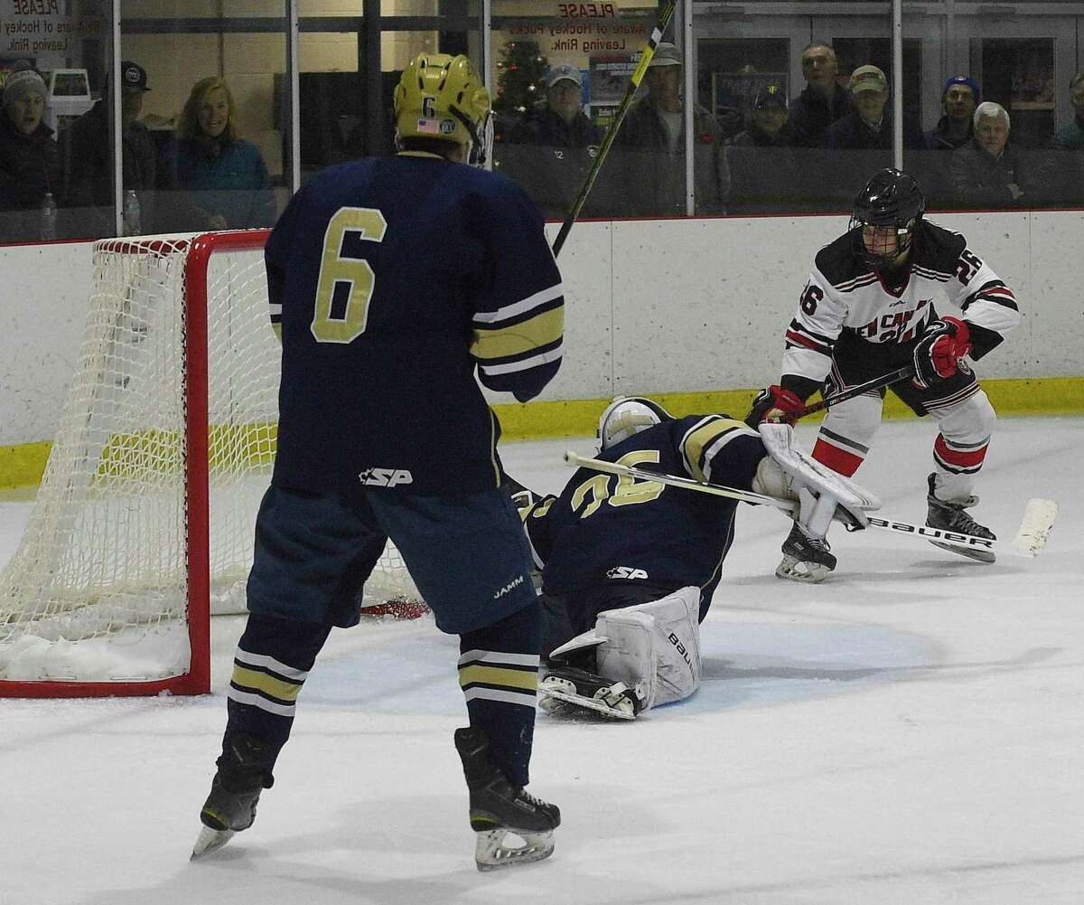 New Canaan's Sam Augustine (26) scores the winning goal on Notre Dame-Fairfield goalie Reagin Gallagher (35) in an over-time period of a boys hockey game at the Darien Ice House on Jan. 4, 2020 in Darien, Connecticut. New Canaan won 3-2 in over-time.