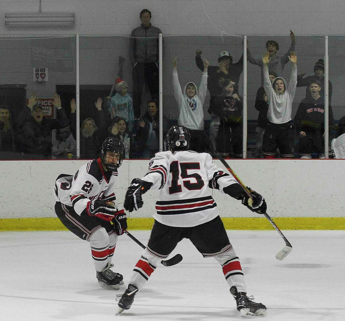 New Canaan's Sam Augustine (26) celebrates his winning goal in over-time against Notre Dame-Fairfield with teammate Nicholas Megdanis (15) in a boys hockey game at the Darien Ice House on Jan. 4, 2020 in Darien, Connecticut. New Canaan won 3-2 in over-time.