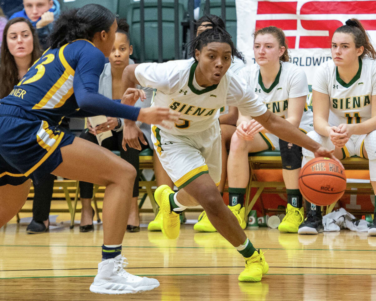 Siena College junior Rayshel Brown drives to the basket in front of Quinnipiac University sophomore Sajada Bonner at the Siena College Alumni Recreation Center in Colonie, NY on Saturday, Jan. 4, 2020 (Jim Franco/Special to the Times Union.)