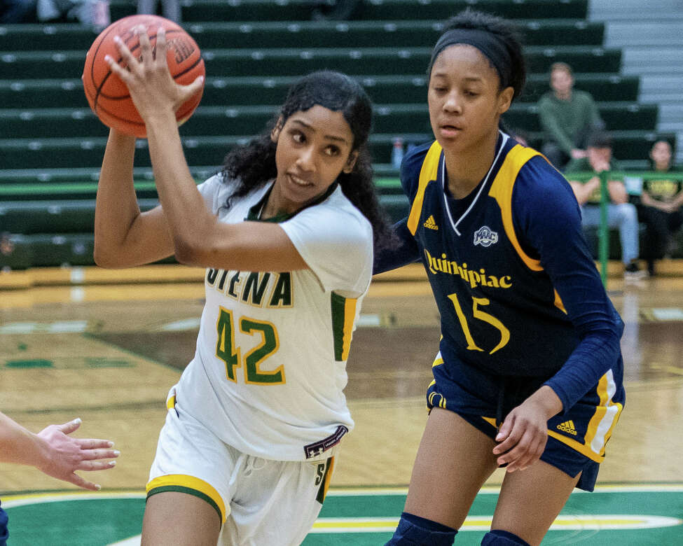 Siena College senior Sabrina Piper drives to the basket in front of Quinnipiac University freshman Cur'Tiera Haywood at the Siena College Alumni Recreation Center in Colonie, NY on Saturday, Jan. 4, 2020 (Jim Franco/Special to the Times Union.)