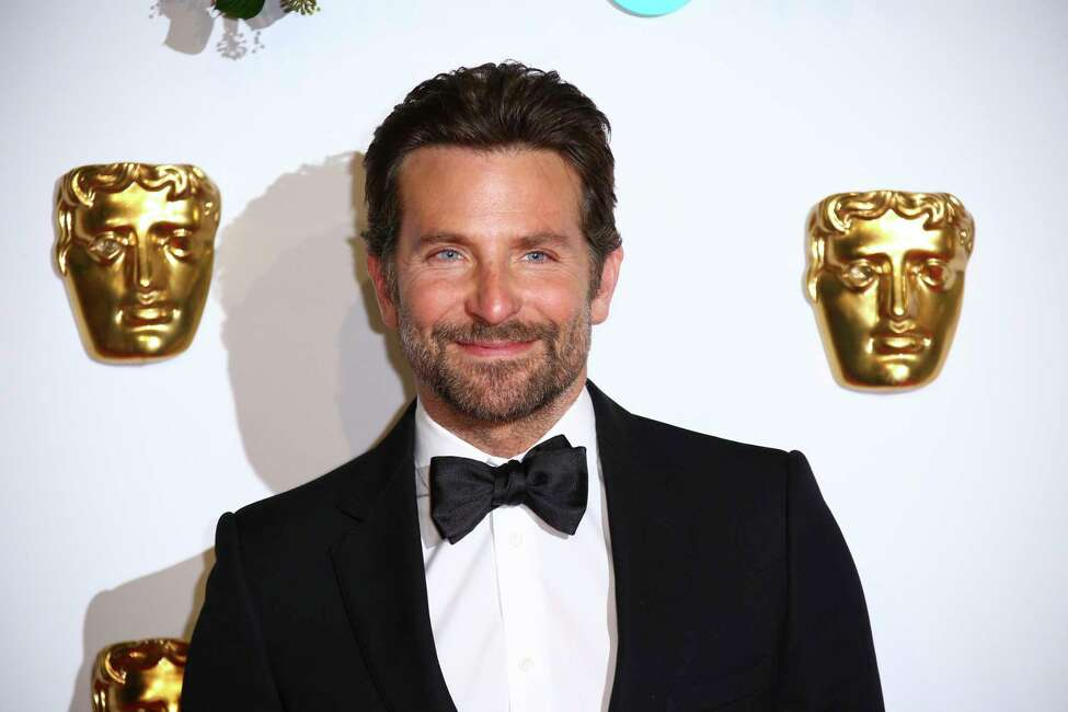 Director and actor Bradley Cooper poses for photographers upon arrival at the BAFTA awards in London, Sunday, Feb. 10, 2019. (Photo by Joel C Ryan/Invision/AP)