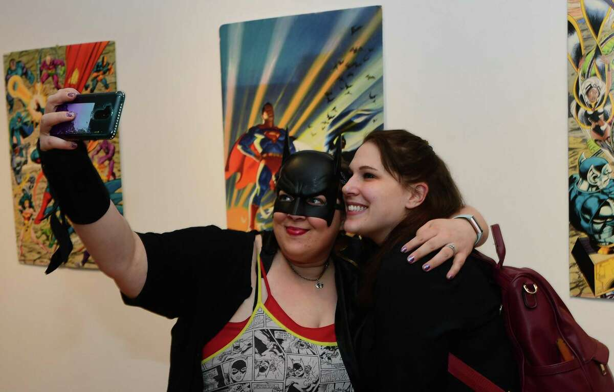 Curator Alexandra McDaniel poses for a photo with guest Kristen Feller during The Rene Soto Gallery Comics & Animation Art Show opening reception Saturday, January 4, 2020, at the gallery on Wall Street in Norwalk, Conn. Artists Al Sarkis Munro and Heather Gil & Naty were featured in the show that was curated by Alexandra McDaniel. Guests at the opening were encouraged to dress up as their favorite comic book characters.