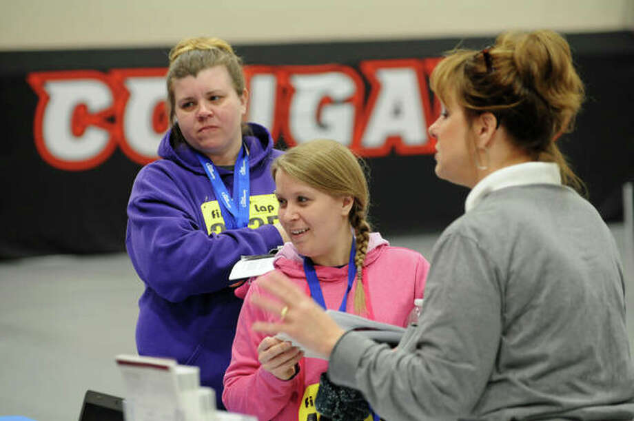 Ami Null, of East Alton, and Krista Coyle, of Bethalto, talk to a New Year, New You Expo vendor. Photo: David Blanchette|For The Intelligencer