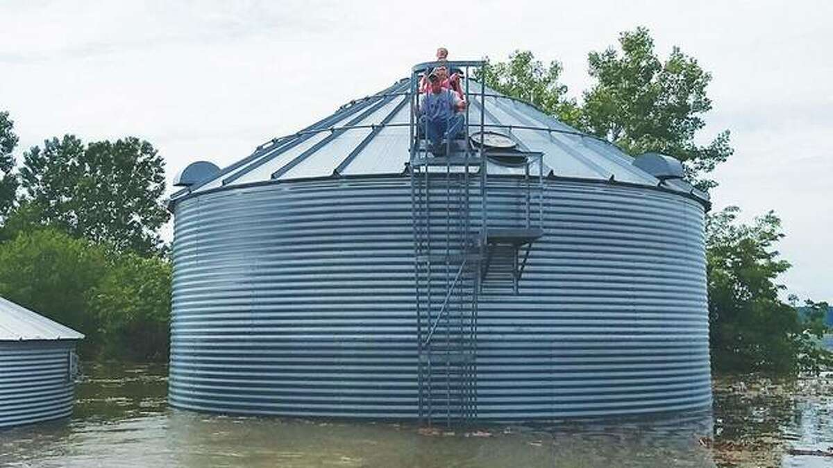 In June, the Fraley family - including Jeff Fraley and his mother, Jennifer, along with Jeff Fraley's two teenage sons - clambered from a boat to the top of a grain bin surrounded by water to survey the damage caused by flooding.