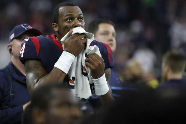 Houston Texans quarterback Deshaun Watson (4) wipes his face on the sideline during the third quarter of an AFC NFL wild card playoff game at NRG Stadium, Saturday, Jan. 4, 2020, in Houston.