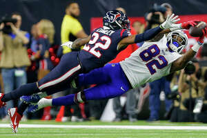 Buffalo Bills wide receiver Duke Williams (82) makes a catch against Houston Texans cornerback Gareon Conley (22) during the third quarter of an AFC Wild Card playoff game at NRG Stadium Saturday, Jan. 4, 2020, in Houston. The Texans won 22-19.