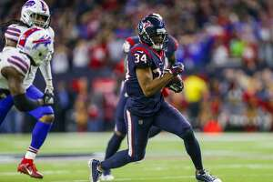 Houston Texans running back Taiwan Jones (34) runs after making a catch for 34 yards, setting up the game-winning field goal against the Buffalo Bills during overtime of an AFC Wild Card playoff game at NRG Stadium Saturday, Jan. 4, 2020, in Houston. The Texans won 22-19.
