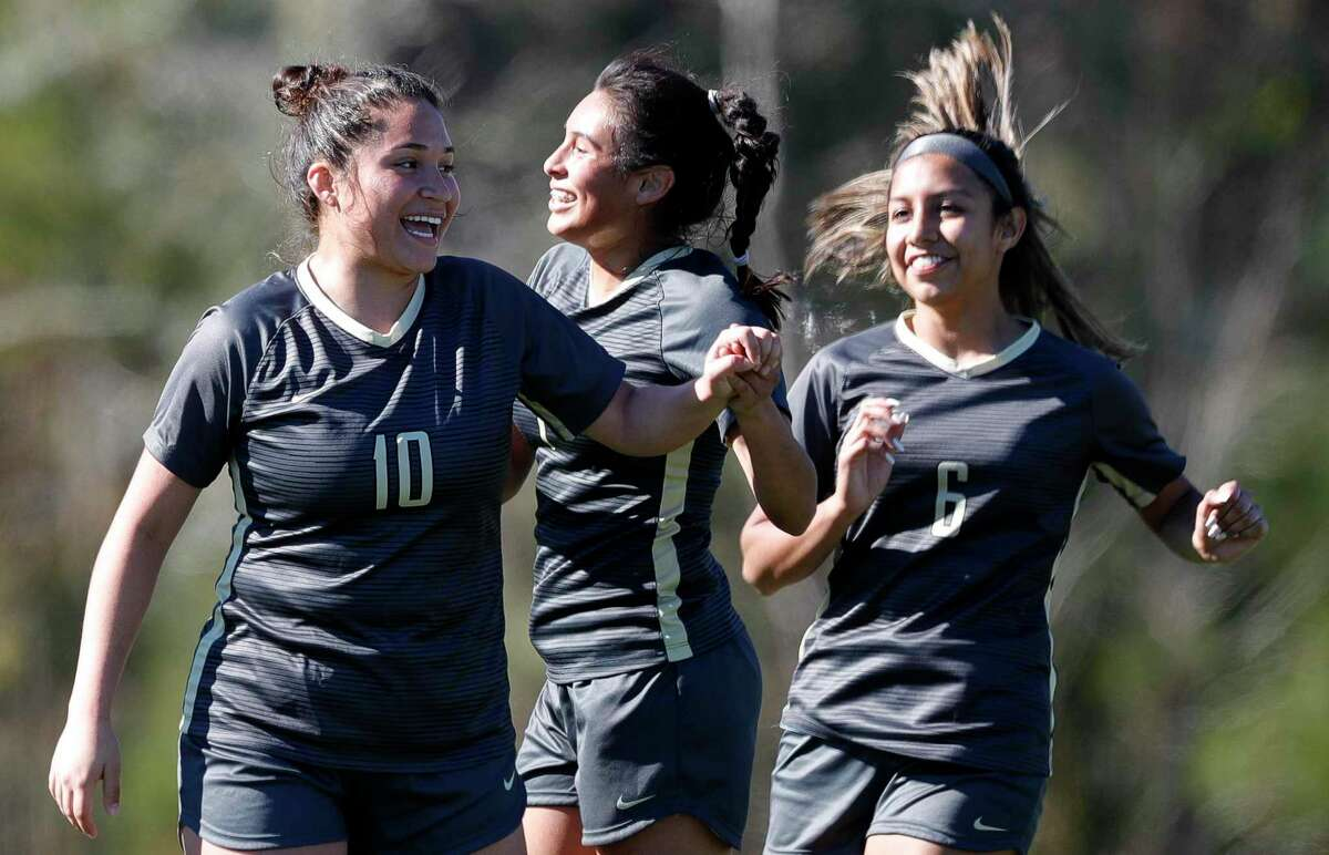 Conroe's Melissa Giron (10) reacts with Brenda Gomez (3) after scoring a penalty kick goal in the second period of a match during the Lady Highlander Invitational at Gosling Sports Complex, Saturday, Jan. 4, 2020, in The Woodlands.