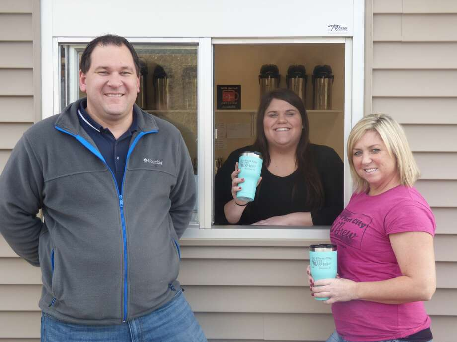 (From left) Ryan Kieszkowski, Bella Willoughby and Heather Schram man the drive through window at Port City Brew. Photo: Scott Fraley/News Advocate