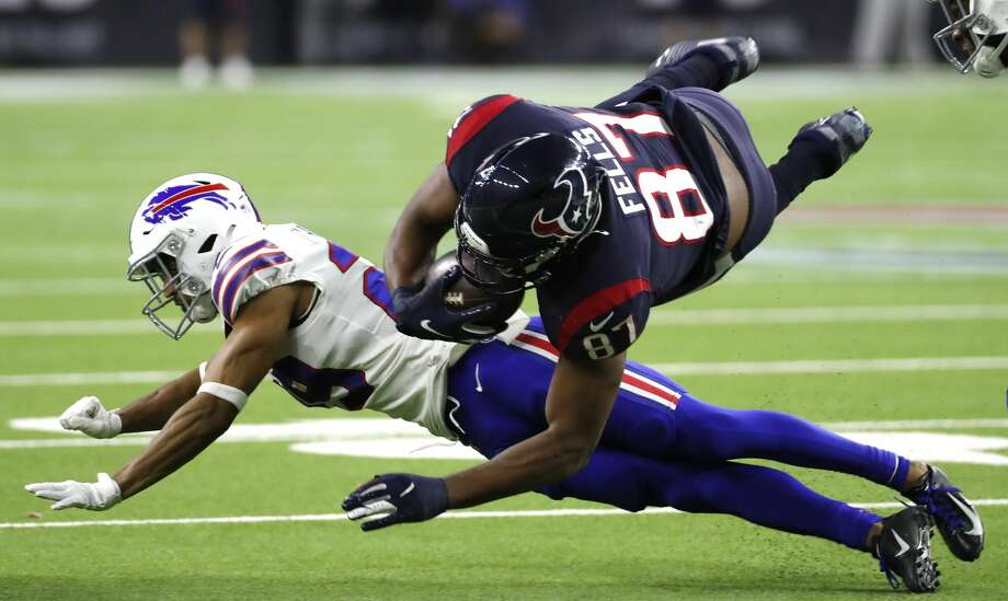 Houston Texans tight end Darren Fells (87) divs over Buffalo Bills cornerback Kevin Johnson (29) during the fourth quarter of an AFC wild card playoff game at NRG Stadium on Saturday, Jan. 4, 2020, in Houston. Photo: Brett Coomer/Staff Photographer