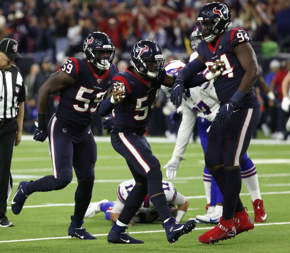 Charles Omenihu (right) and Jacob Martin (center) are two of the young defenders whose upsides the Texans must properly assess before making moves in the offseason.