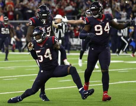 Houston Texans linebacker Jake Martin (54) celebrates his sack of Buffalo Bills quarterback Josh Allen during the fourth quarter of an AFC wild card playoff game at NRG Stadium on Saturday, Jan. 4, 2020, in Houston.