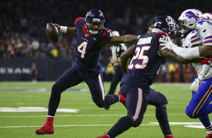 Houston Texans quarterback Deshaun Watson (4) runs for a successful two-point conversion against the Buffalo Bills during the third quarter of an AFC Wild Card playoff game at NRG Stadium Saturday, Jan. 4, 2020, in Houston.