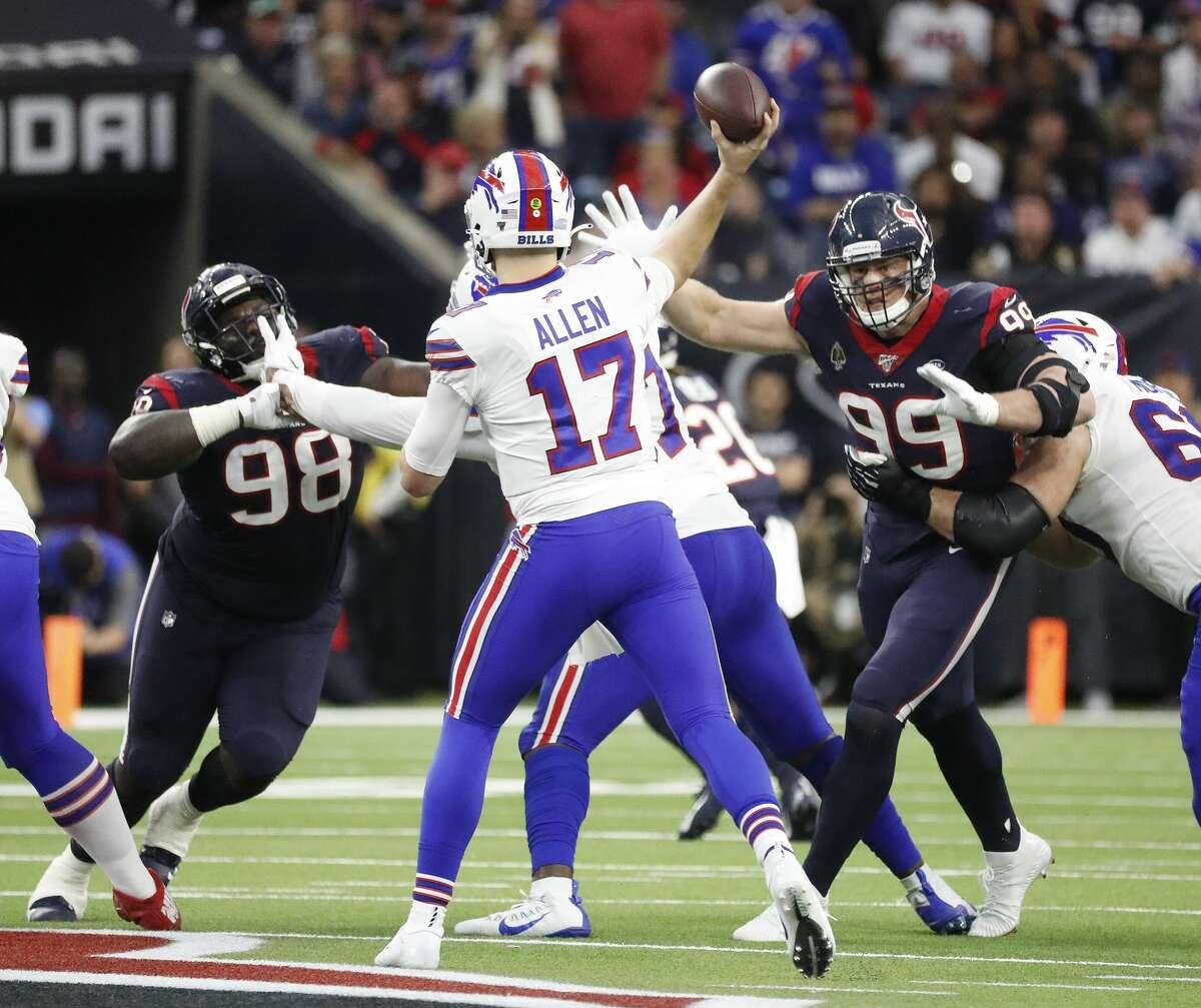 Houston Texans defensive end J.J. Watt (99) puts pressure on Buffalo Bills quarterback Josh Allen (17) during the second quarter of an AFC NFL wild card playoff game at NRG Stadium, Saturday, Jan. 4, 2020, in Houston.