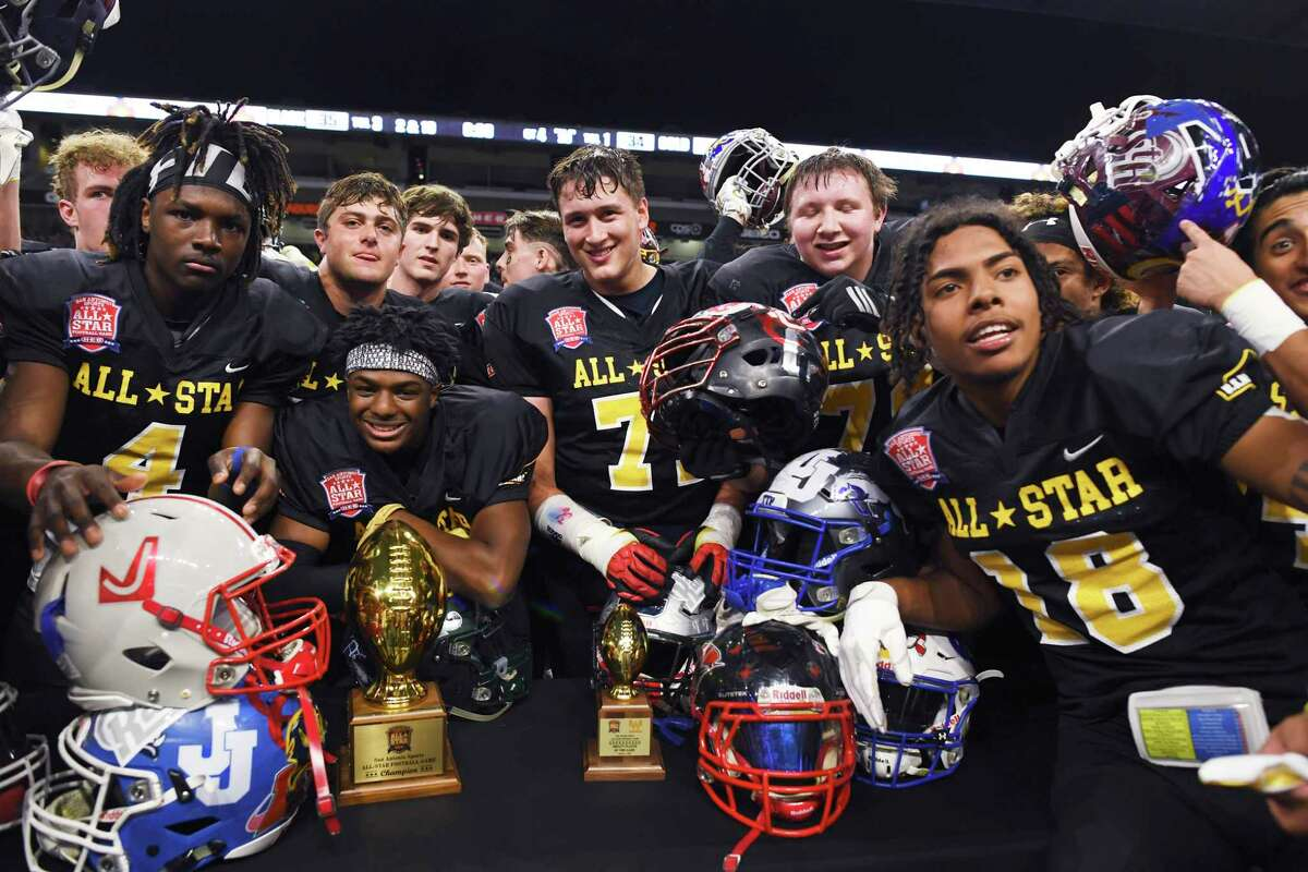 Team Black celebrates after defeating Team Gold, 35-34, in the San Antonio Sports All-Star Football Game in the Alamodome on Saturday, Jan. 4, 2020.