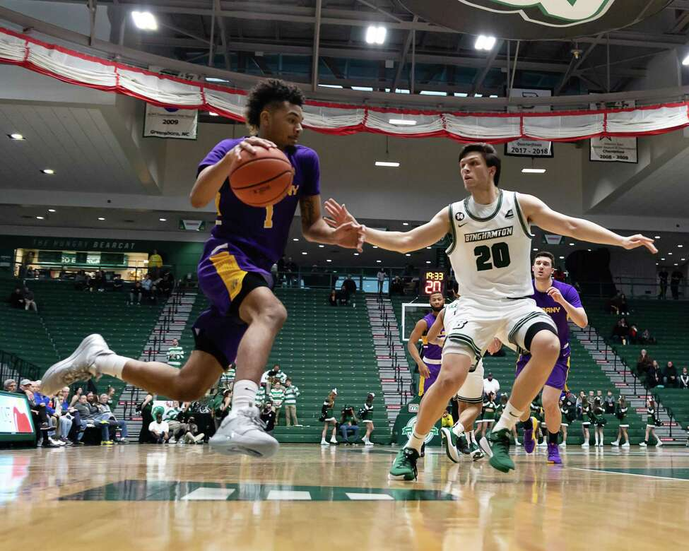UAlbany's Malachi de Sousa drives against George Tinsley of Binghamton during their game Saturday, Jan. 4, 2020. (Courtesy of Brent Warzocha)
