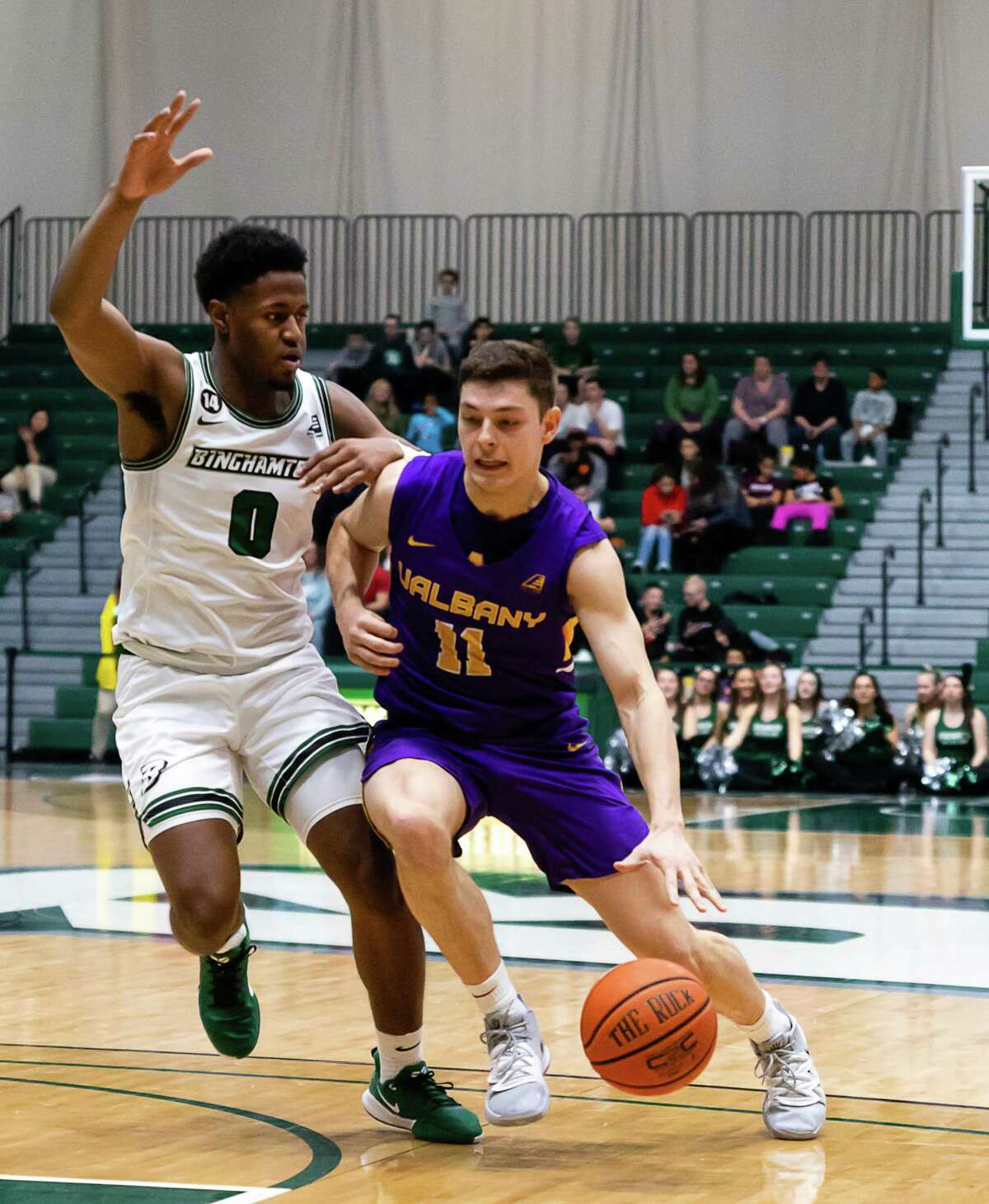 UAlbany's Cameron Healy dribbles around Binghamton's Richard Caldwell Jr. during their game Saturday, Jan. 4, 2020. (Courtesy of Brent Warzocha)