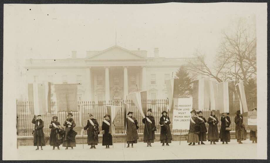 "Photo provided by the Library of Congress howing Suffragists picketing in front of the White House in 1917. Celebrating the 85th anniversary of women's right to vote in all U.S, elections, the Library of Congress is putting on line photos of the suffrage movement entitled, Women of Protest"". (AP Photo/Library of Congress) Photo: AP / LIBRARY OF CONGRESS"
