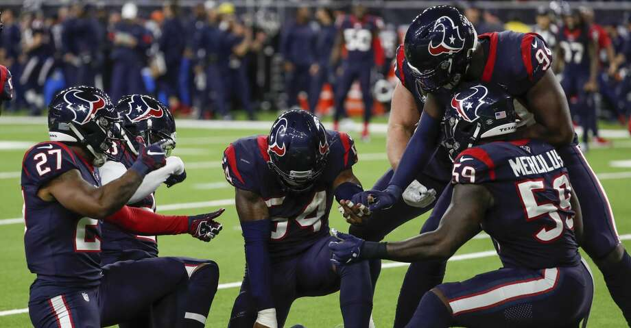Houston Texans linebacker Jake Martin (54) and the rest of the defense celebrate Martin's sack of Buffalo Bills quarterback Josh Allen during the fourth quarter of an AFC wild card playoff game at NRG Stadium on Saturday, Jan. 4, 2020, in Houston. Photo: Brett Coomer/Staff Photographer