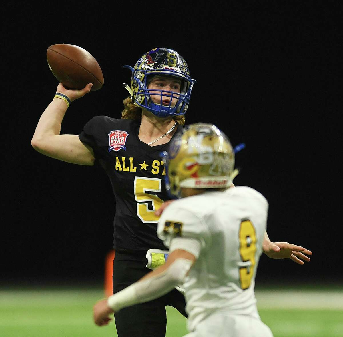 Team Black quarterback Trapper Pannell throws against Team Gold during the second half of the San Antonio Sports All-Star Football Game in the Alamodome on Saturday, Jan. 4, 2020. Pannell plays for Tivy High School.