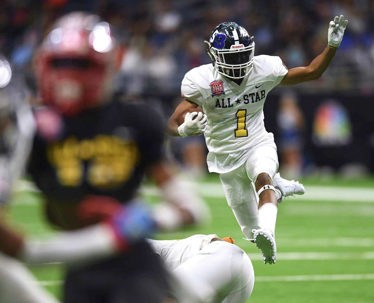 Greg Eggleston of Team Gold hurdles during the San Antonio Sports All-Star Football Game in the Alamodome on Saturday, Jan. 4, 2020. He attends Smithson Valley High School.